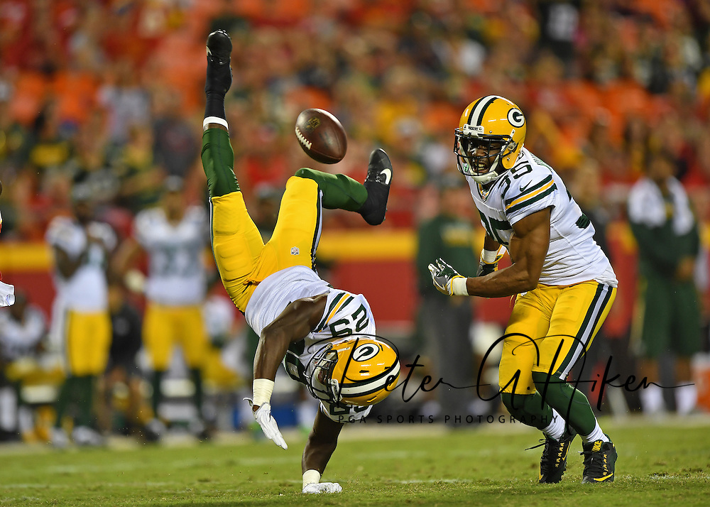 Safety Kentrell Brice #29 of the Green Bay Packers can't hold onto a potential interception against the Kansas City Chiefs, as teammate Jermaine Whitehead #35 looks on, during the second half at Arrowhead Stadium in Kansas City, Missouri.