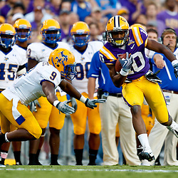 October 16, 2010; Baton Rouge, LA, USA; LSU Tigers wide reciever Russell Shepard (10) runs past McNeese State Cowboys safety Darrell Jenkins (9) during a game at Tiger Stadium. LSU defeated McNeese State 32-10. Mandatory Credit: Derick E. Hingle
