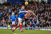 Portsmouth Midfielder, Tom Naylor (7) beats Sunderland Forward, Duncan Watmore (14) to the ball during the EFL Sky Bet League 1 match between Portsmouth and Sunderland at Fratton Park, Portsmouth, England on 22 December 2018.