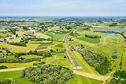 Nederland, Gelderland, Duiven, 09-06-2016; Groessen, natuurgebied Kandia. Betuweroute met dienstgebouw van de tunnel onder het Pannerdensch kanaal, in oostelijke richting.<br /> Tunnel Betuweroute, freight railway, Pannerdensch channel (Lower Rhine) on the horizon.<br /> <br /> luchtfoto (toeslag op standard tarieven);<br /> aerial photo (additional fee required);<br /> copyright foto/photo Siebe Swart