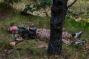 A boy participating to the ultra-nationalistic Azovets children's camp is lying on the grass, exhausted at the end of a laser-gun teams battle on the banks of the Dnieper river, in Kiev, Ukraine's capital.