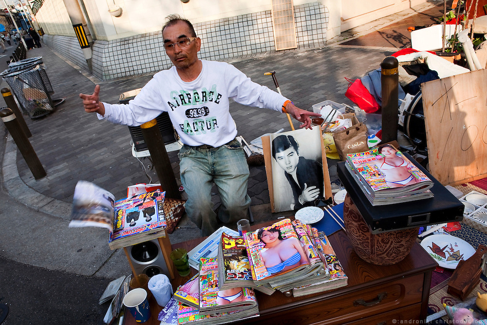 Man selling seccond hand things in Kamagasaki.