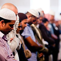 London, UK - 20 July 2012: Muslim faithful celebrates the first day of Ramadan in the East London Mosque, the largest in Britain.
