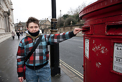 "© licensed to London News Pictures. London, UK 12/02/2012. Gay rights campaigner and Pride London's manager Martine Whitaker posting her Valentine's Day card to Buckingham Palace calling on the Queen to help ""kiss goodbye to homophobia"" in some Commonwealth countries. Photo credit: Tolga Akmen/LNP"