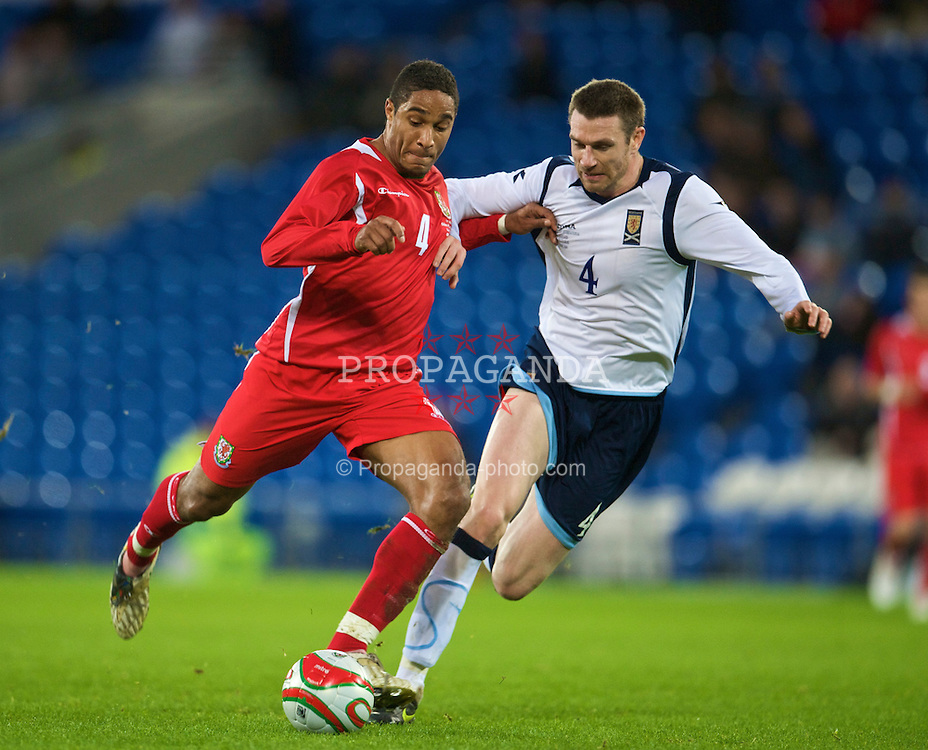 CARDIFF, WALES - Saturday, November 14, 2009: Wales' captain Ashley Williams and Scotland's Stephen McManus during the international friendly match at the Cardiff City Stadium. (Pic by David Rawcliffe/Propaganda)
