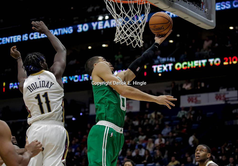 Nov 26, 2018; New Orleans, LA, USA; Boston Celtics forward Jayson Tatum (0) shoots over New Orleans Pelicans guard Jrue Holiday (11) during the second half at the Smoothie King Center. Mandatory Credit: Derick E. Hingle-USA TODAY Sports