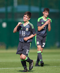 WREXHAM, WALES - Monday, July 22, 2019: Jake Roberts of North celebrates scoring his sides third goal to make the score 3-2 during the Welsh Football Trust Cymru Cup 2019 at Colliers Park. (Pic by Paul Greenwood/Propaganda)