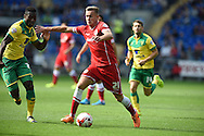 Joe Ralls of Cardiff city &copy; breaks away to score his sides 1st goal. Skybet football league championship match, Cardiff city v Norwich city at the Cardiff city Stadium in Cardiff, South Wales on Saturday 13th Sept 2014<br /> pic by Andrew Orchard, Andrew Orchard sports photography.