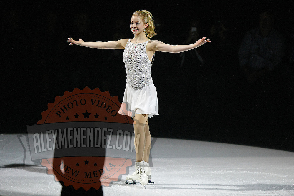 Olympic Bronze medalist Gracie Gold smiles during the Stars on Ice Figure Skating opening act at the Amway Center on Sunday, April 6, 2014 in Orlando, Florida. (AP Photo/Alex Menendez)