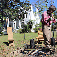 Butch Skelton of Cottondale, Alabama prepares breakfast for last year's encampment group on the front lawn of The Magnolias. Several reminders of the late 1800s and early 1900s will be among events highlighting the Aberdeen Pilgrimage Friday, Saturday and Sunday.