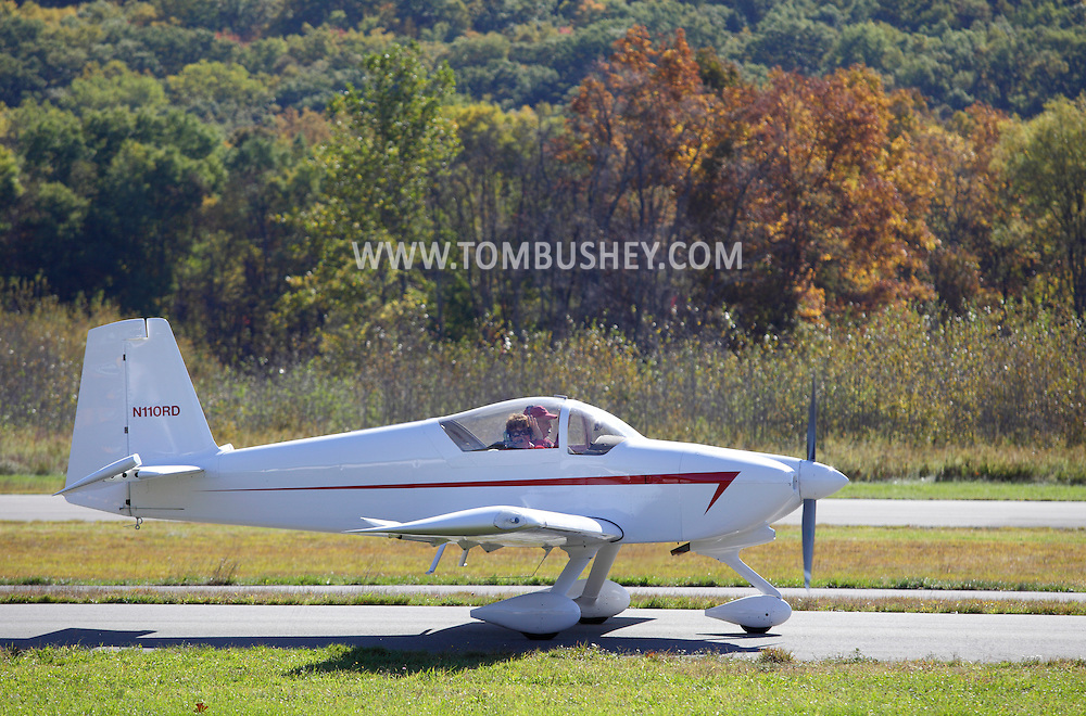Wurtsboro, New York - A woman waves from the cockpit of a plane moving down the runway at Wurtsboro Airport on Oct. 9, 2010.