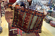 carpet seller displaying his carpets Istanbul