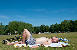 ©Licensed to London News Pictures 19/05/2020  <br /> Greenwich, UK. A man sunbathing under a blue sky. Warm sunny weather in Greenwich park, Greenwich, London today as people get out of the house from coronavirus lockdown to relax, sunbathe or walk in the park. Photo credit:Grant Falvey/LNP