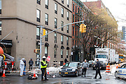 A male cyclist lies on the road talking on his phone after falling off his bike which crashed with the black VW car on East Houston Street in Lower East Side, New York City, New York, Unites States of America. An NYPD officer walks towards him, while the male drive of the car stands and watches. A workman with a STOP sign controls the traffic.  (photo by Andrew Aitchison / In pictures via Getty Images)