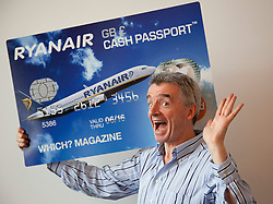 © Licensed to London News Pictures. 10/10/2011. LONDON, UK. Michael O'Leary, CEO of budget airline Ryanair, poses with a mockup of his company's new 'Cash Passport' debit card. The card, launched today (11/10/11) aims to allow Ryanair's regular customers to avoid its £6 admin fee when booking flights. Photo credit: Matt Cetti-Roberts/LNP