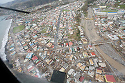 An aerial view of Roseau, the capital of the Caribbean island of Dominica, taken from an RAF Chinook helicopter the day after Hurricane Maria struck.