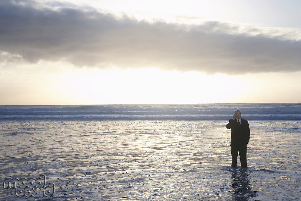 Businessman Standing in the Ocean