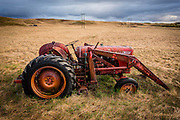 This old red tractor is one of the many abandoned vehicles at Holmur