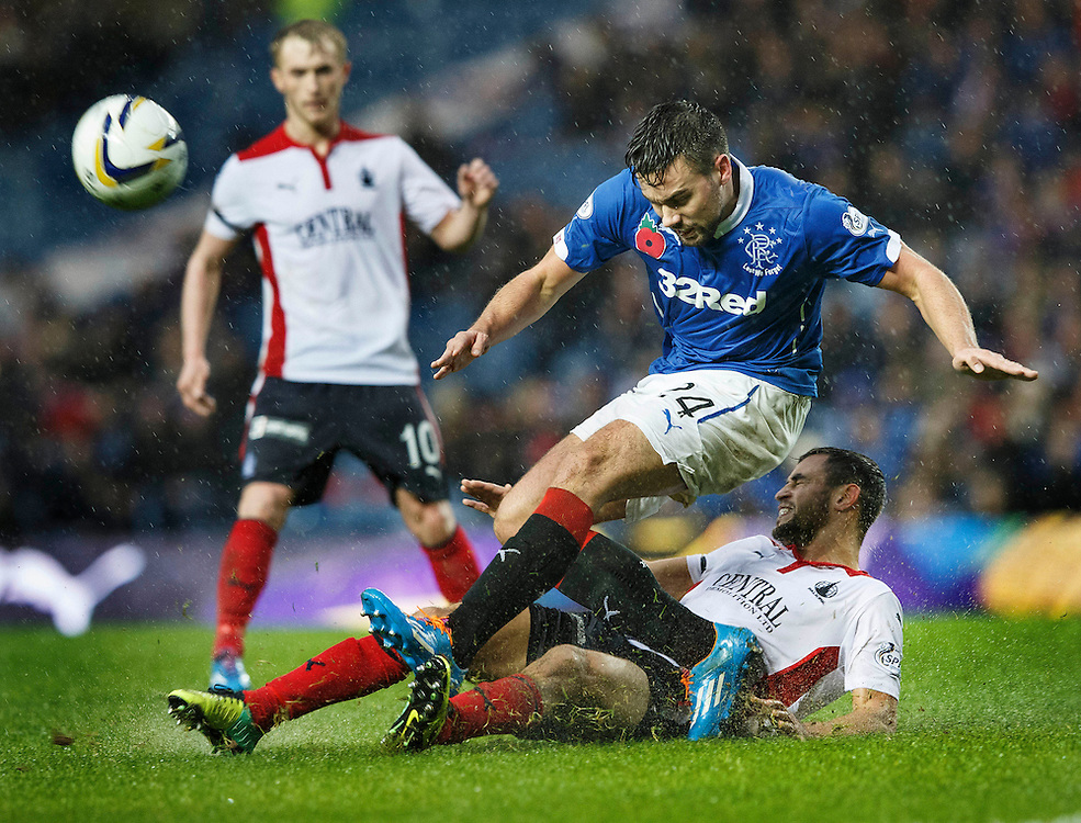 Rangers v Falkirk. Ibrox. SFL Championship.  Tom Taiwo slides in on Ranger's Darren McGregor.   Picture Robert Perry 8th Nov 2014
