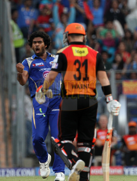 Mumbai Indians player Lasith Malinga celebrates the wicket Sunrisers Hyderabad player David Warner during match 23 of the Pepsi IPL 2015 (Indian Premier League) between The Mumbai Indians and The Sunrisers Hyderabad held at the Wankhede Stadium in Mumbai India on the 25th April 2015.<br /> <br /> Photo by:  Vipin Pawar / SPORTZPICS / IPL