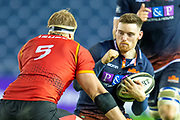 George Taylor (#13) of Edinburgh Rugby prepares to take a hit from John-Charles Astle (#5) of Isuzu Southern Kings during the Guinness Pro 14 2018_19 rugby match between Edinburgh Rugby and Isuzu Southern Kings at the BT Murrayfield Stadium, Edinburgh, Scotland on 5 January 2019.