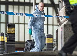 © Licensed to London News Pictures. 05/03/2019. London, UK. A forensics officer enters Waterloo Station as police deal with a suspicious package. The Metropolitan Police counter terrorism command has said that small improvised explosive devices have been found at the station, at Heathrow and London City airport. Photo credit: Peter Macdiarmid/LNP