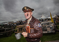 A man dressed in vintage clothing attends at the Goodwood Revival in Chichester, England   Friday, Sept. 9, 2016 The historic motor racing festival celebrates the mid-20th-century golden era of the racing circuit and recreates the atmosphere from the 1950s and 1960s.(Elizabeth Dalziel)
