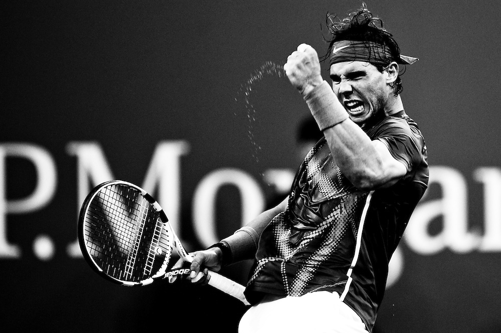 NEW YORK, NY - SEPTEMBER 12: ***EDITORS NOTE*** (This image has been digitally converted to Black&White) Rafael Nadal of Spain reacts with a fist pump after a point in a match against Novak Djokovic of Serbia  during the Men's Final on Day Fifteen of the 2011 US Open at the USTA Billie Jean King National Tennis Center on September 12, 2011 in the Flushing neighborhood of the Queens borough of New York City. (Photo by Rob Tringali) *** Local Caption *** Rafael Nadal