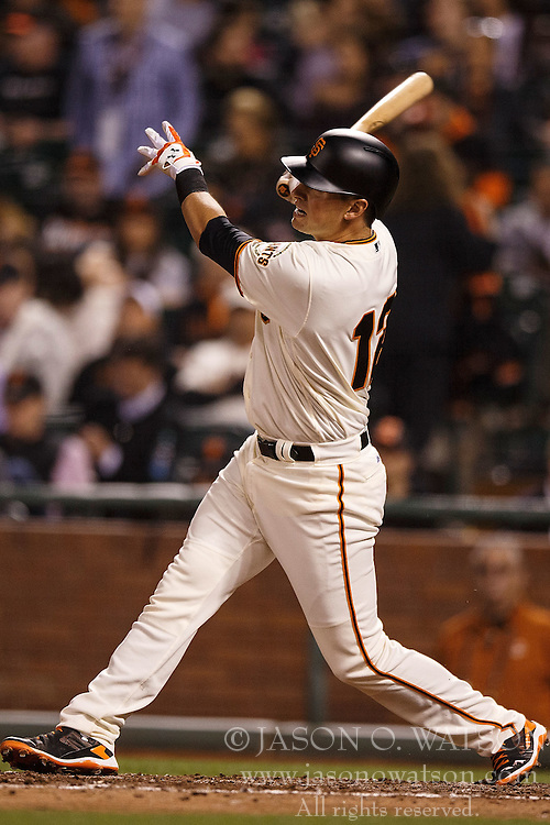 SAN FRANCISCO, CA - APRIL 18: Joe Panik #12 of the San Francisco Giants hits a home run against the Arizona Diamondbacks during the fifth inning at AT&T Park on April 18, 2016 in San Francisco, California. The Arizona Diamondbacks defeated the San Francisco Giants 9-7 in 11 innings.  (Photo by Jason O. Watson/Getty Images) *** Local Caption *** Joe Panik