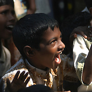 Children in Chinnangudi, a 540-family fishing village in Tamil Nadu, India, laugh at jokes told by a volunteer from AID India, a non-profit organization, on January 16, 2005 after the area was struck by the Indian Ocean Tsunami on December 26, 2004. Generated by an earthquake on the ocean floor, the tsunami devastated the fishing industry along the southeastern coast of India. .
