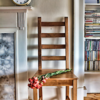 Mantelpiece, Wooden chair and bookcase in front room