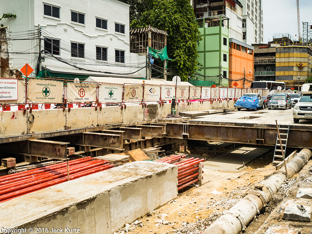 08 JUNE 2016 - BANGKOK, THAILAND:  Some of the subway construction at the intersection of Phlap Phla Chai and Chareon Krung Streets in Bangkok's Chinatown neighborhood. The Bangkok Metropolitan Rapid Transit (MRT) system, Bangkok's subway, is being expanded through Chinatown and a station is under construction at the intersection. The small produce market at the intersection will have to move and several of the businesses near the intersection have been evicted to make way for the construction. Bangkok's Chinatown, considered by some to be one of the best preserved Chinatown districts in the world, is changing. Many of the old shophouses are being demolished and replaced by malls and condominium developments.     PHOTO BY JACK KURTZ