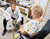 Patient being fitted with a prosthetic leg