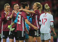 Football - 2019 / 2020 Women's International Friendly - England vs. Germany<br /> <br /> German's Sara Doorsoun and Kathrin Hendrich celebrate their 2-1 victory at the final whistle, at Wembley Stadium.<br /> <br /> COLORSPORT/ANDREW COWIE