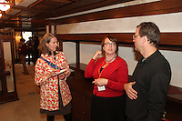 People came out Friday evening for the final After Hours event of April at the Robie where they were treated to food, music and tours of the historic house. The Robie House is located at 5757 S. Woodlawn.<br /> <br /> 2441 – Robie House Group Tours and Facilities Rental Manager Elizabeth Murphy (center) spoke with Pam Fischer and Erik Newman about the house.