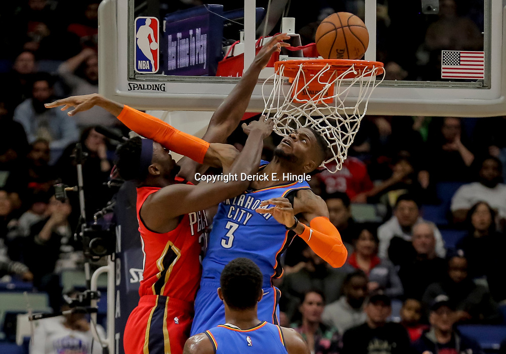 Dec 12, 2018; New Orleans, LA, USA; Oklahoma City Thunder forward Nerlens Noel (3) fouls New Orleans Pelicans forward Julius Randle (30) on an attempted dunk during the first quarter at the Smoothie King Center. Mandatory Credit: Derick E. Hingle-USA TODAY Sports