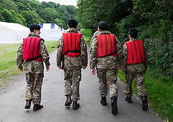 © Licensed to London News Pictures.13/06/15<br /> Durham, England<br /> <br /> Army cadets wearing life jackets make their way to the control point at the start of the 182nd Durham Regatta rowing event held on the River Wear. The origins of the regatta date back  to commemorations marking victory at the Battle of Waterloo in 1815. This is the second oldest event of this type in the country and attracts over 2000 competitors from across the country.<br /> <br /> Photo credit : Ian Forsyth/LNP