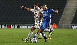 Marcus Maddison of Peterborough United in action with Callum Brittain of Milton Keynes Dons - Mandatory by-line: Joe Dent/JMP - 04/09/2018 - FOOTBALL - Stadium MK - Milton Keynes, England - Milton Keynes Dons v Peterborough United - Checkatrade Trophy