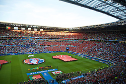 LYON, FRANCE - Wednesday, July 6, 2016: Wales and Portugal players line-up for the national anthems ahead of the UEFA Euro 2016 Championship Semi-Final match at the Stade de Lyon. (Pic by Paul Greenwood/Propaganda)