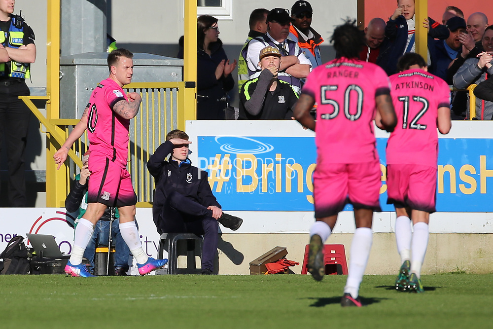 Southend United striker Simon Cox (10) celebrating after scoring 0-2 during the EFL Sky Bet League 1 match between AFC Wimbledon and Southend United at the Cherry Red Records Stadium, Kingston, England on 25 March 2017. Photo by Matthew Redman.