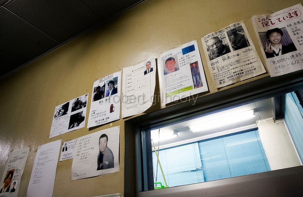 Posters of missing persons are displayed on the wall of a fire station near Aokigahara Jukai, better known as the Mt. Fuji suicide forest, in Yamanashi Prefecture, west of Tokyo, Japan on 02 Nov. 2009.