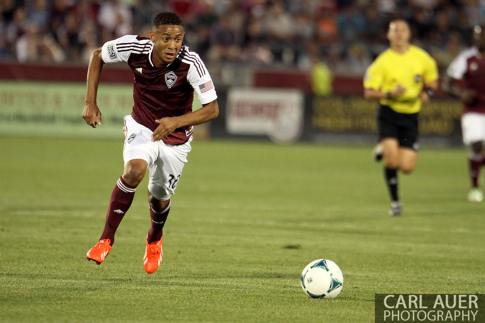 August 17th, 2013 - Colorado Rapids forward Gabriel Torres (30) quickly dribbles the ball up the field in the first half of action in the Major League Soccer match between the Vancouver Whitecaps FC and the Colorado Rapids at Dick's Sporting Goods Park in Commerce City, CO