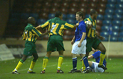 WIDNES, ENGLAND - Tuesday, March 11, 2003: Everton's Wayne Rooney gets aggressive with West Brom Reserves' Lloyd Dyer (l) as Tamika Mkandawire steps in during in the Premier Reserve League (Northern Division) at the Halton Stadium. (Pic by David Rawcliffe/Propaganda)