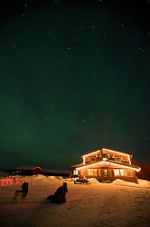 The historic landmark Bettles Lodge sits 35 miles north of the Arctic Circle, beneath the northern lights.
