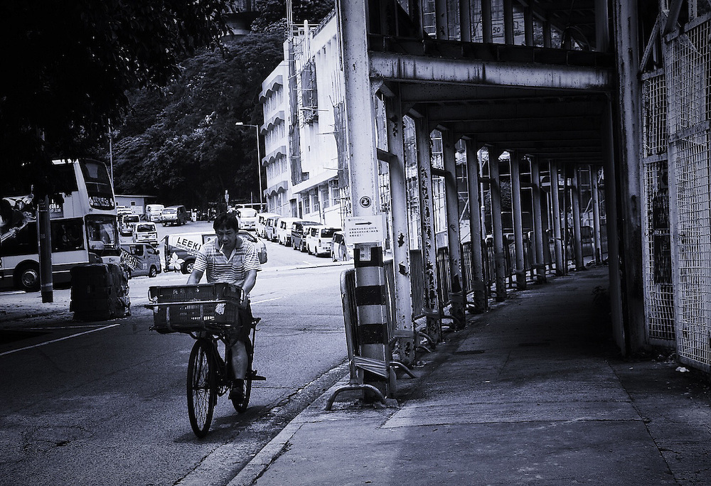 Side by Tara Pangestu.<br /> <br /> Tara Pangestu works in Hong Kong as a domestic helper. Being a minority in Hong Kong has made her distinctly curious about the world around her. She found a voice and a sense of belonging when she started taking photographs of the city&rsquo;s busy streets.