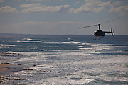 A helicopter over Las Marias beach in Rincon Puerto Rico