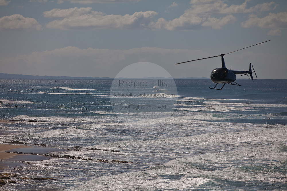 A helicopter over Las Marias beach in Rincon Puerto Rico