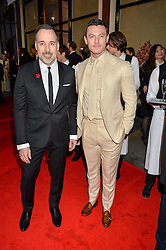 Left to right, DAVID FURNISH and LUKE EVANS at the launch of the new Bulgari flagship store at 168 New Bond Street, London on 14th April 2016.