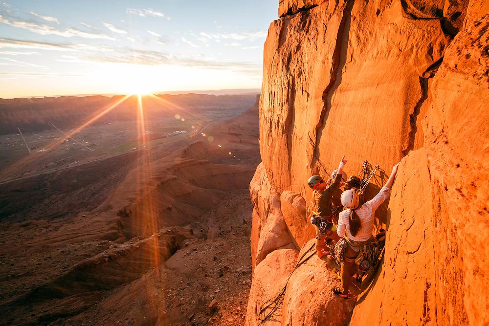 Kim Hall, Julia Geisler and Jewell Lund climbing Fine Jade, 5.11-, Castle Valley, Utah.