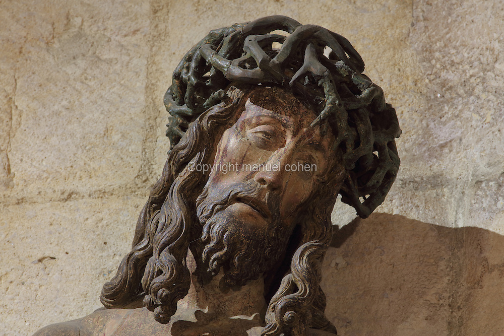 Detail of the Passion of Christ, a late 15th century sculpture of Christ with hands and feet bound, wearing the crown of thorns, sculpted from one oak trunk, in the Salle des Povres or Room of the Poor, in Les Hospices de Beaune, or Hotel-Dieu de Beaune, a charitable almshouse and hospital for the poor, built 1443-57 by Flemish architect Jacques Wiscrer, and founded by Nicolas Rolin, chancellor of Burgundy, and his wife Guigone de Salins, in Beaune, Cote d'Or, Burgundy, France. The hospital was run by the nuns of the order of Les Soeurs Hospitalieres de Beaune, and remained a hospital until the 1970s. The building now houses the Musee de l'Histoire de la Medecine, or Museum of the History of Medicine, and is listed as a historic monument. Picture by Manuel Cohen